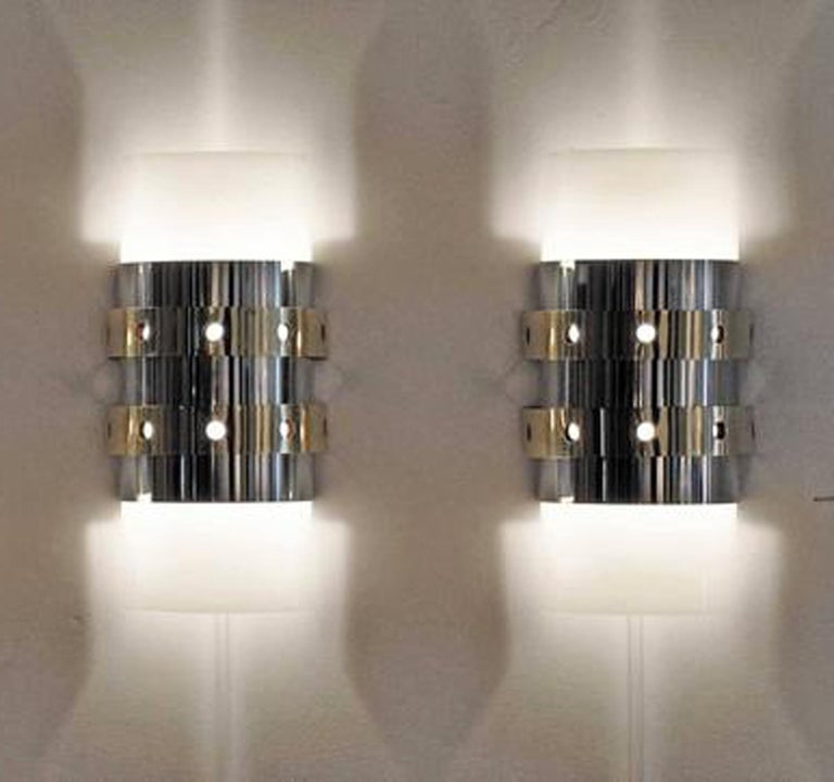 Pair of modernist, 1970s acrylic, polished chrome, and brass wall sconces. Rewired and ready for use. Price is for the pair.