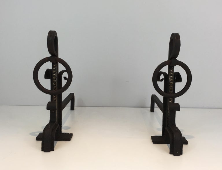 This pair of modernist andirons is made of wrought iron with a brass decoration on the front. This is a French work. Arts & Crafts, circa 1900.