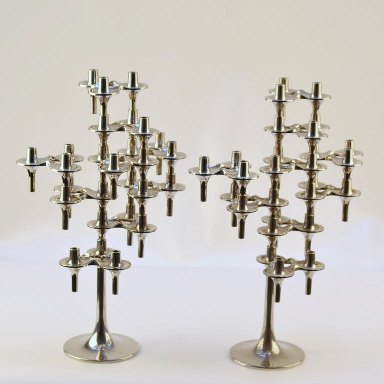 Set of two chromed candelabras stands with each 9 modular pieces. Orion Mid-Century Modern candle holders were designed by Fritz Nagel & Ceasar Stoffi, 1960. Orion candle holders were at manufactured by BMF (Bayerische Metallwaren Fabrik) Nagel in