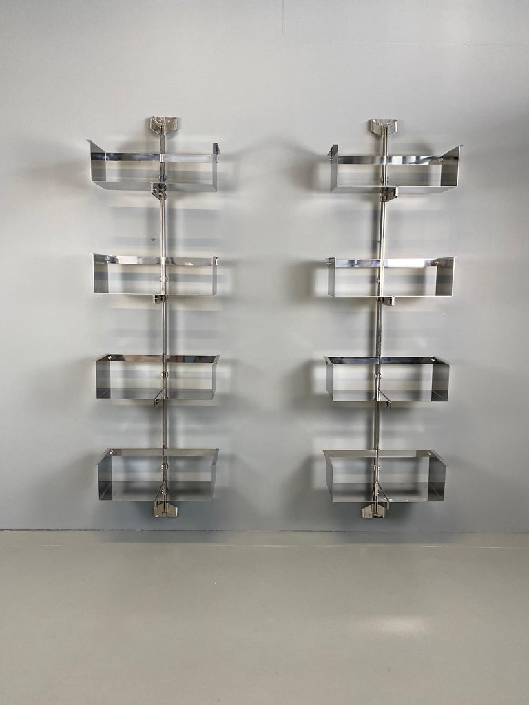 Pair of modular wall-mounted shelving system designed by Vittorio Introini, produced by Saporiti, Italy, circa 1969. Whit original label. Stainless steel, very good condition. Shelves can be used individually or combined together in many different