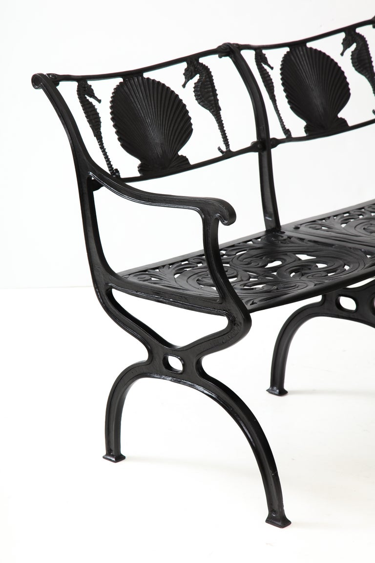 Pair of Molla shell and seahorse motif backrest cast aluminium benches.