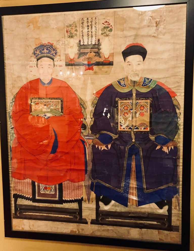Ancient Chinese paintings on rice paper. Pair of 19th century Chinese paintings of ancestor portraits painted on rice paper and mounted in simple black lacquered frames. Juxtaposed, each portraits depict an aged but richly dressed couple seated in