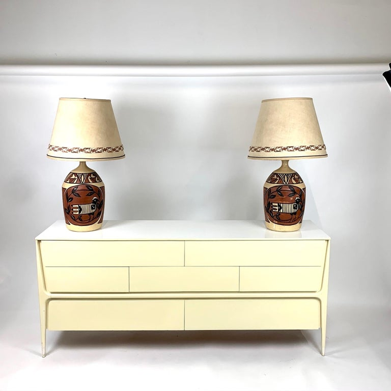Gorgeous painted large scale lamps from the 1960s-1970s. These ceramic lamps are painted in a southwestern or Aztec style. Also reminiscent of Picasso's painting style. Lamps are absolutely striking in person. Overall: 36
