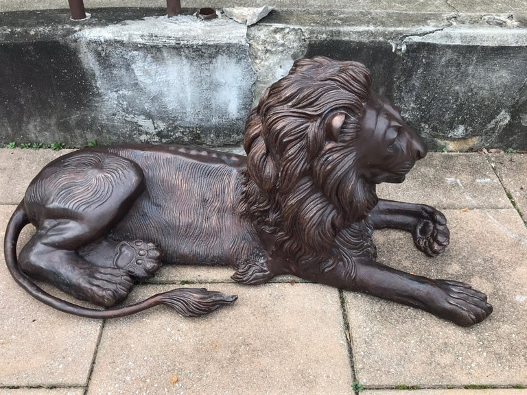 Cast Pair of Monumental Bronze Recumbent Lions For Sale