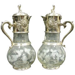 Pair of Monumental English Sliver Plated and Engraved Glass Claret Jugs