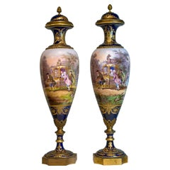 Pair of Monumental Painted Sèvres Porcelain Vase and Cover