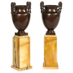 Pair of Mounted Urns