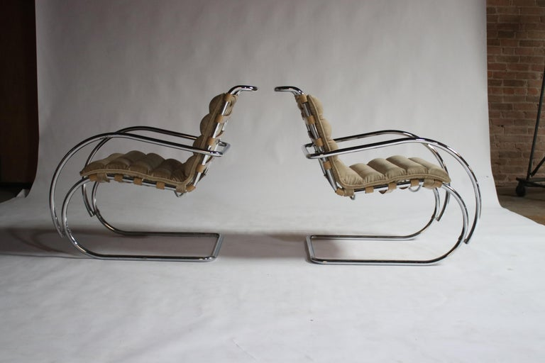 Pair of MR Lounge armchairs by Mies van der Rohe in original camel strap leather and polished chrome with newly upholstered camel color mohair pads.