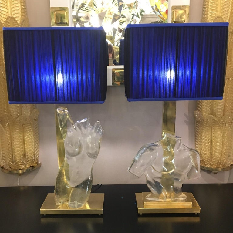 Pair of Murano clear glass sculpture representing masculine and feminine bust. Brass rectangular base and structure. Handmade rectangular lampshades, double color silk chiffon (royal blue inside and blue black outside). Measurements without the