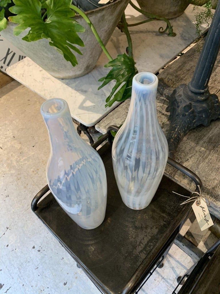 Lovely pair of tall slim and exceptionally beautiful semi-transparent hand blown glass vases, designed as elegant bottles. Produced around the 1960s on the world-famous island of Murano, a stone's throw from the canal city of Venice in