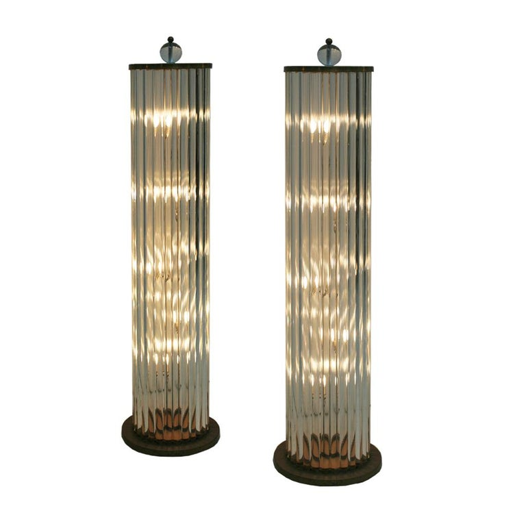 Pair of lamps made with white metallic structure, Murano glass pieces and brass details.