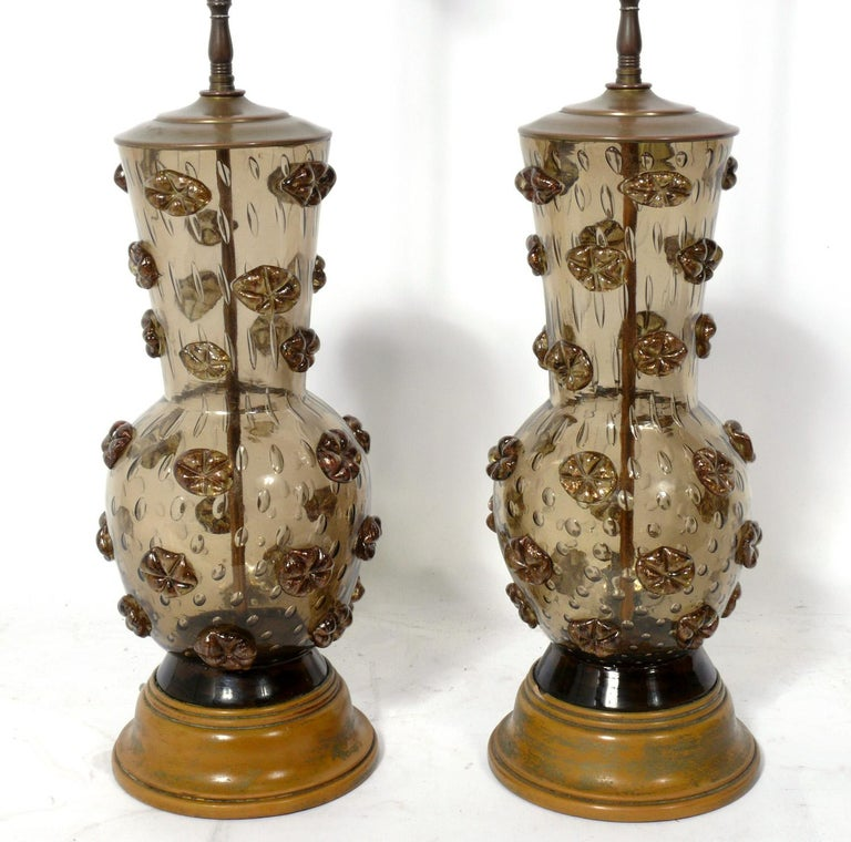 Pair of Murano glass lamps, Italy, circa 1960s. They are a champagne-brown color. They have been rewired and are ready to use. The price noted includes the shades.