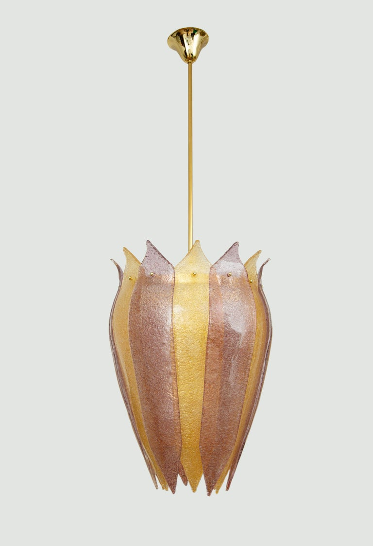 """Pair of Murano glass lantern or cesendello, in stock Curved form """"graniglia"""" hand blown glass leaves in gold and amethyst. Silhouette is inspired by the ancient street lanterns of Venice Brass structure with a 65"""