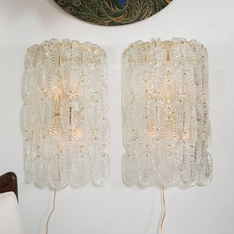 Pair of sconces composed of fluted, linked Murano glass elements by Barovier with brass hardware.