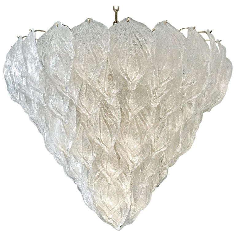 Murano polar ice chandelier, each with 88 precious hand blown glass leaves hanging on the brass frame. Spectacular light effect. Available three pairs of sconces. Provenance from a luxury hotel. Measures: Height 75 cm, with chain 140 cm Ten E 27