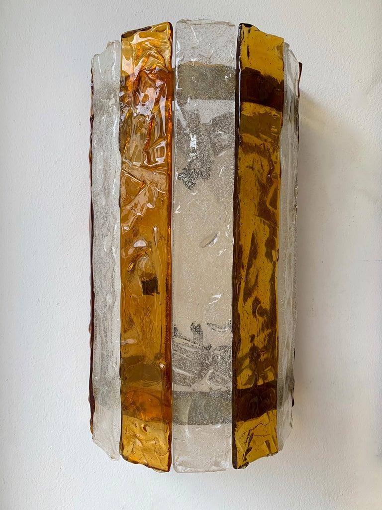 Amber and clear Murano glass and metal wall lights lamps sconces by the manufacture Mazzega Murano. Famous design like Venini, Aldo Carlo Nason, Poliarte, La Murrina, Vistosi.