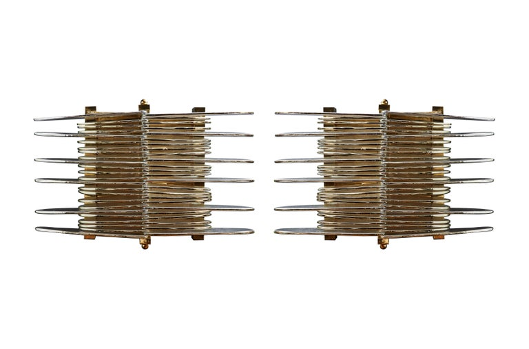 Pair of beautiful wall sconces in brass and Murano glass blades. Modern creation by Studio Glustin.