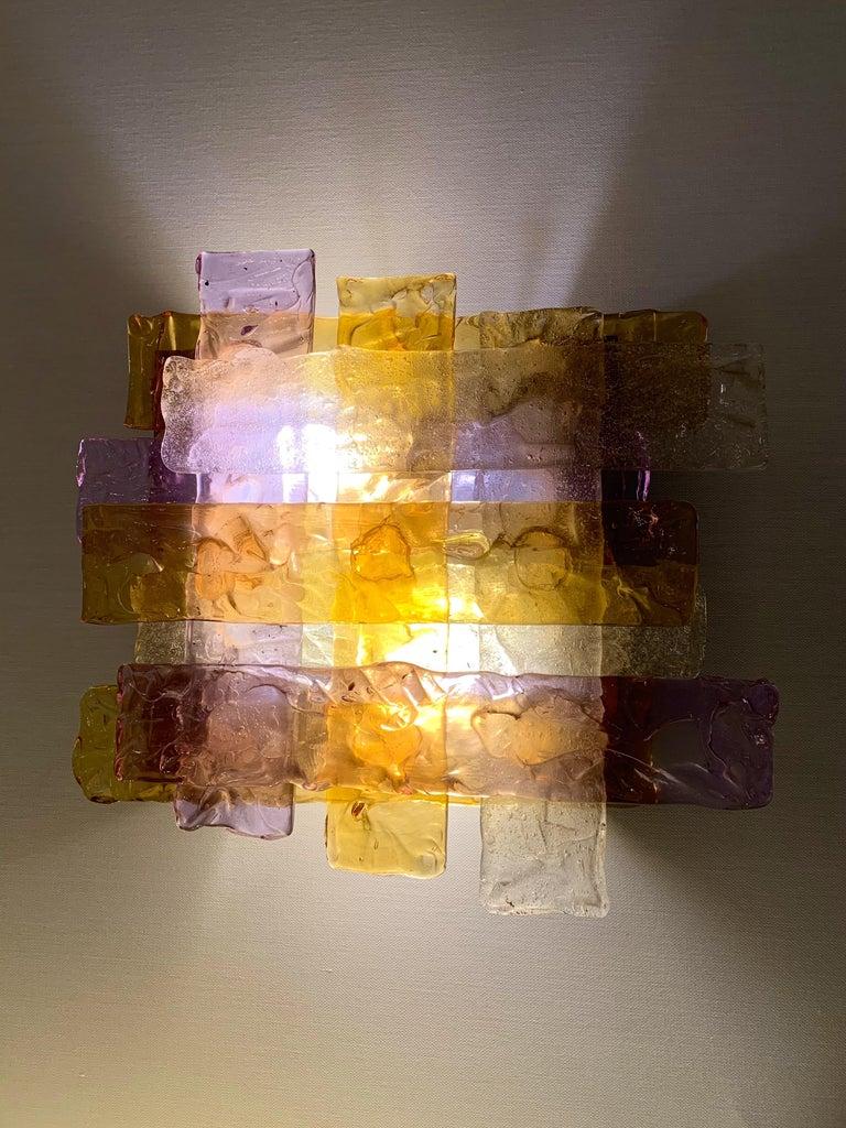 Rare model of braided purple, amber and clear Murano glass wall lights sconces by the manufacture Venini design attributed to Toni Zuccheri. Famous design like Mazzega, Aldo Carlo Nason, Poliarte, La Murrina.