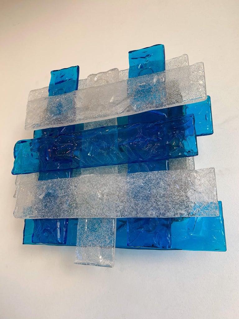 Rare model of braided blue and clear Murano glass wall lights lamps sconces by the manufacture Mazzega Murano design attributed to Toni Zuccheri. Famous design like Venini, Aldo Carlo Nason, Poliarte, La Murrina.