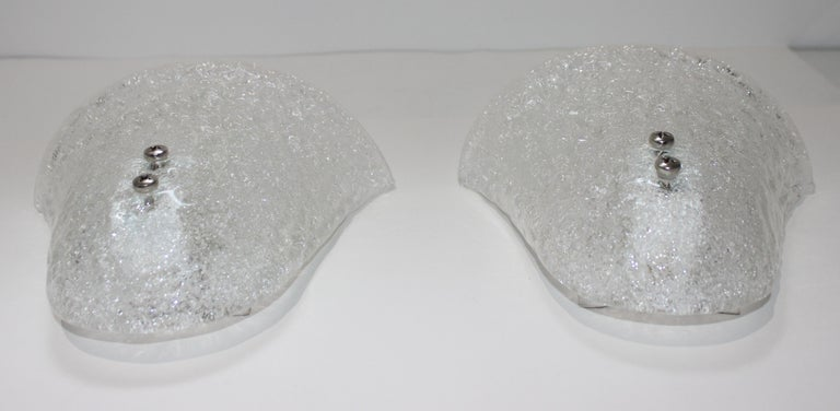 This stylish pair of Murano glass wall sconces date to the 1970s.  Note: They can be hung either way, up or down (see last image).  Note: Because these are handmade, there is slight variation in size, for example, the width varies from 8.5
