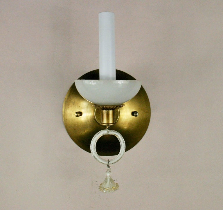 2-417, pair of handmade Murano glass sconces with curved brass backplates.