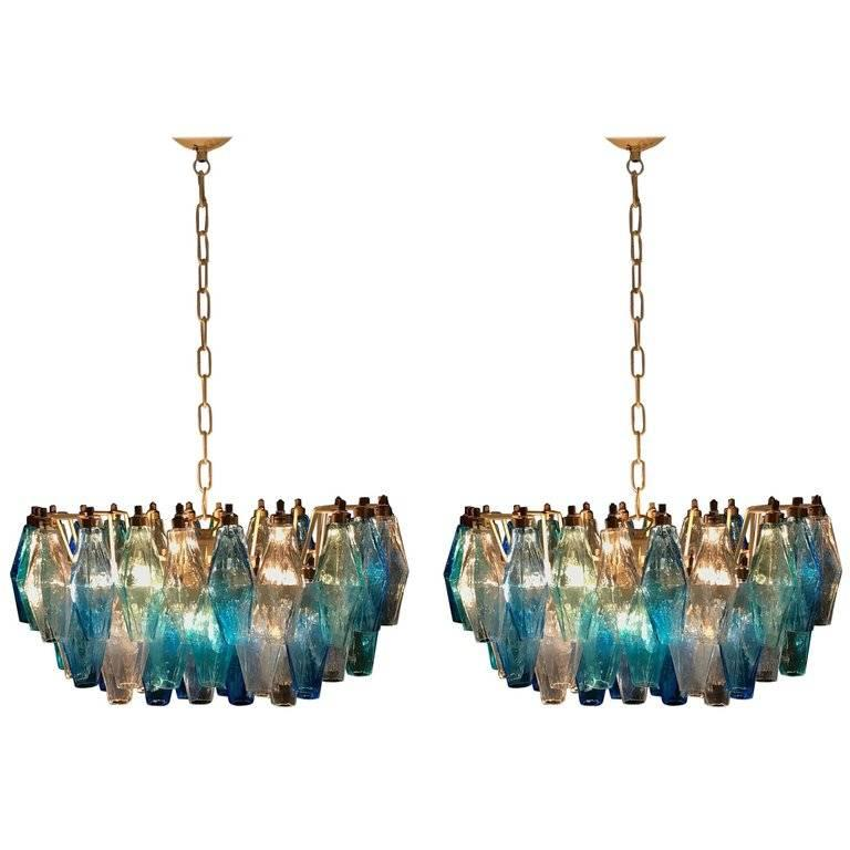 Each chandelier consists of 52 colored Poliedri of Murano. Ice, blue and aquamarine. Measures: cm H 80, L 50, W 35 height lights, without chain 30 cm. Available three pairs.