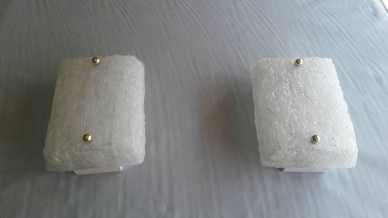 Beautiful Mid-Century Modern pair of sconces in Murano glass in a shape of an icy brick from late 1950s and beginning of the 1960s edited by Kalmar, Austria.  In an excellent general state without any traces. The electric part if it's the US