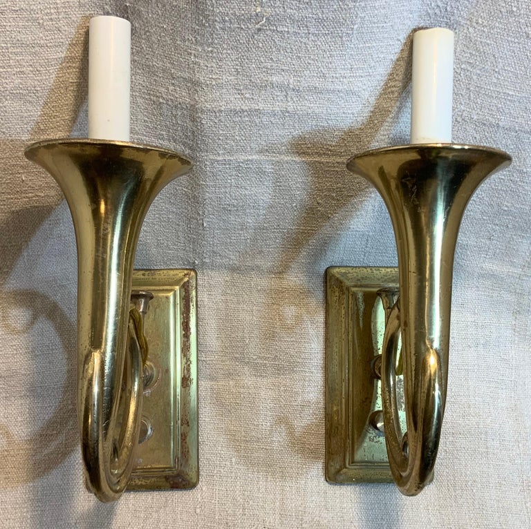 """Unusual pair of musical wall sconces, look like trumpet. Made of solid brass One 60/watt light each. Ready to light. Backplate size 3"""" x 6""""."""