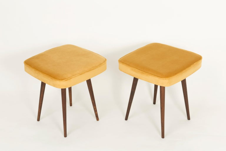 Stools from the turn of the 1960s and 1970s. Beautiful mustard velor upholstery. The stools consists of an upholstered part, a seat and wooden legs narrowing downwards, characteristic of the 1960s style. We can prepare this pair also in another