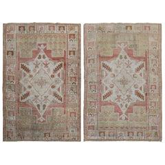 Pair of Muted Vintage Turkish Oushak Rugs