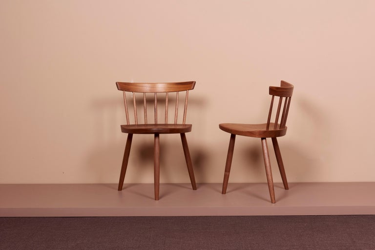 Pair of the mira chair by Nakashima Woodworkers. The chairs are in black walnut and signed.