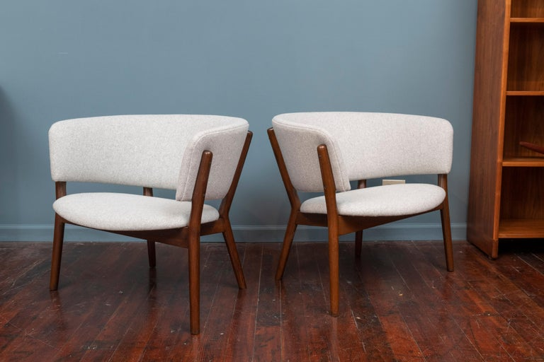 Pair of Nanna Ditzel design lounge chairs, newly upholstered in a light grey wool with refinished frames.