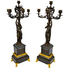 Pair of Napolean III Patinated Bronze Figural Candelabra