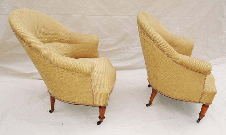 A solid pair of Napoleon III armchairs covered in pale gold corduroyed velvet, circa 1900. Original wheels. Seat hgt.: 16.5