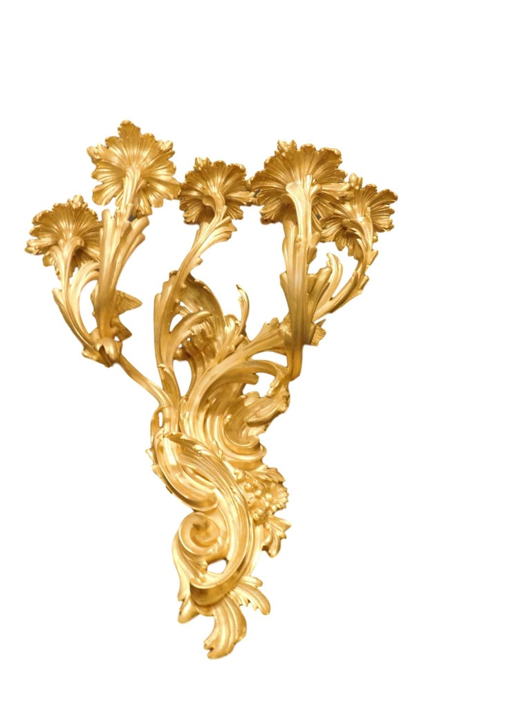 Impressive pair of gilt bronze sconces by Victor Paillard during the Second Empire, Napoleon III period. Exquisitely cast in the highest quality mercury gilt bronze with a deep, warm and glowing patina. Crisp detailed sculpted Rococo leafy C-scroll