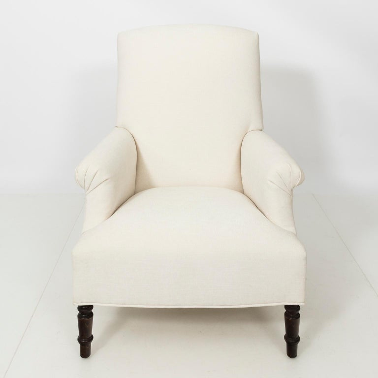 Pair of Napoleon III style armchair with oak ring turned legs in newly upholstered fabric.