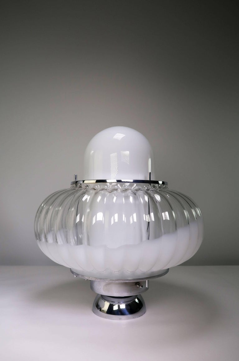 Two stunningly luxurious, large Italian Mid-Century Modern Atomic Age Mazzega Murano statement table lamps by glass artist Carlo Nason. Two glass shades nesting within each other to create a spectacular and sculptural UFO like form with chrome