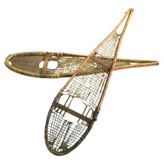 Pair of Native American Rawhide Pom Pom Snowshoes, Late 19th-Early 20th Century