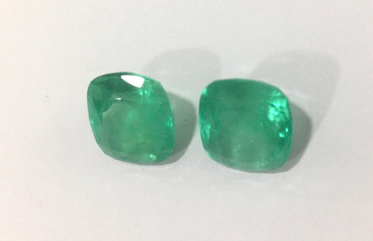 Two natural Colombian emeralds, medium green cushion cut, total weight 11,63 carats( 6.15ct and 5.48ct). Good for earrings, ring and or pendant necklace! *Included Certificate*  The emeralds can be sold as a set or individually. So please contact us