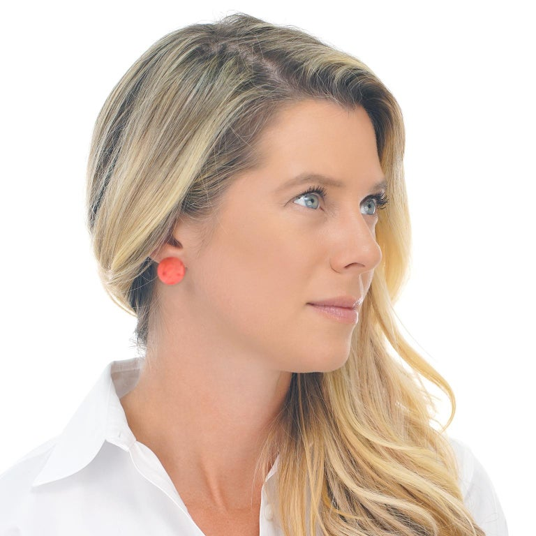 Circa 1950s, 18K, Italian with restored findings.    A modernist take on the definitive button earring, these chic natural coral cabochons (GIA Report) are perfect for any moment of fashion. Needing no artifice to achieve brilliant minimalism, the