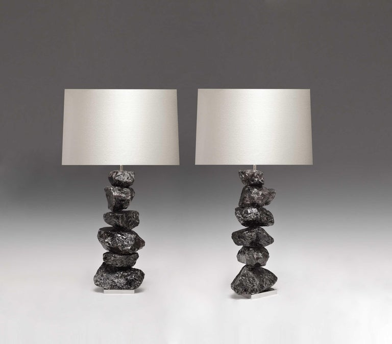 A pair of luxury natural form dark rock crystal quartz lamps with nickel plating bases. Created by Phoenix Gallery, NYC.