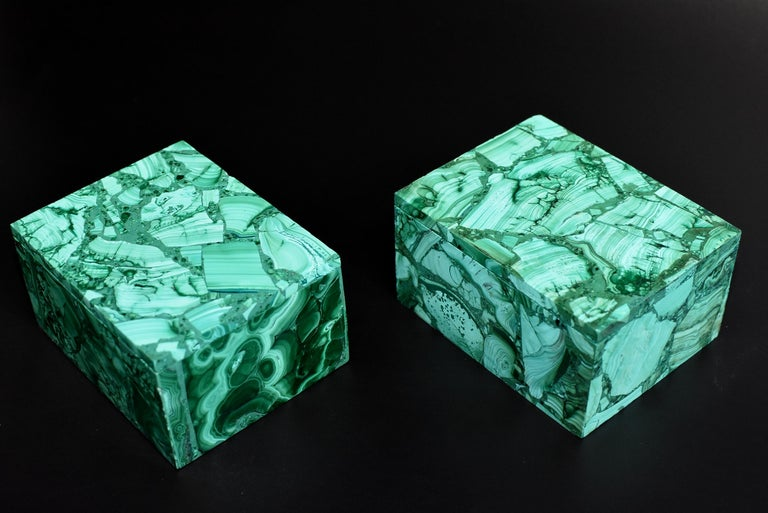 A pair of full slab, spectacular all natural malachite boxes for any purpose. Splendid swirls and patterns, this remarkable pieces adds a luxurious and sophisticated touch to your home. Malachite is a stone of transformation, helping one achieve