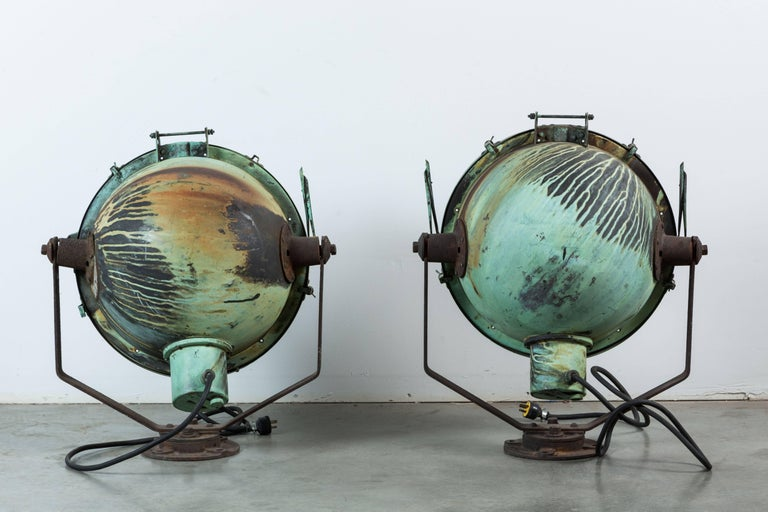 Pair of copper nautical ship lights with amazing original patina. Very sturdy and solid lights. These have been rewired and are in working order. They look great with a large Edison bulb. Also work very well facing a wall for accent lighting. Please