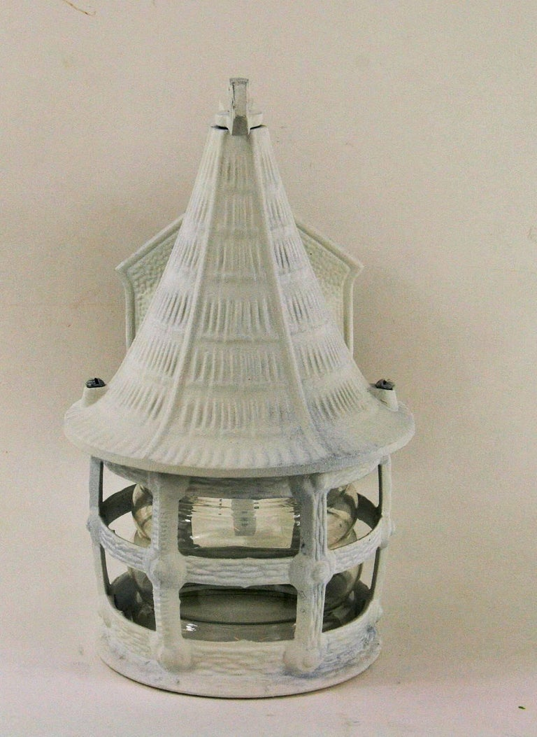 #2-426 a pair of Tudor style metal hand painted wall lantern-sconce having a cylindrical internal glass. Newly rewired.