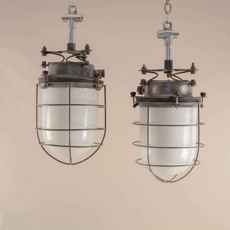 Pair of nautical or industrial milk glass and steel caged pendant pair of 1960s maritime ships galley pendant lights from eastern europe each with a milk aloadofball Images