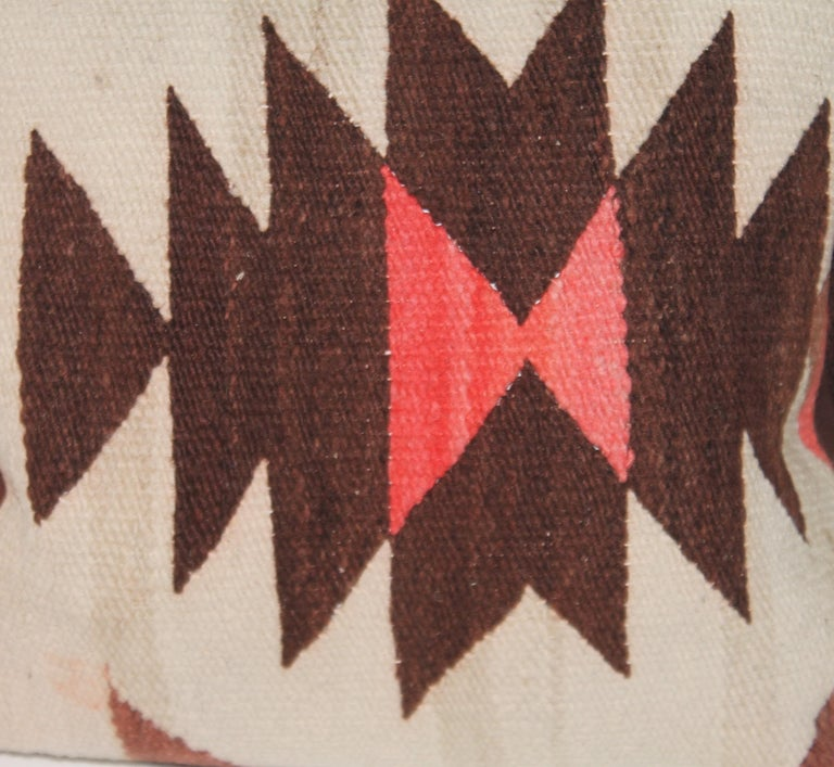 Navajo geometric Indian weaving pillows in a pair. The backings are in brown cotton linen and down & feather filled.