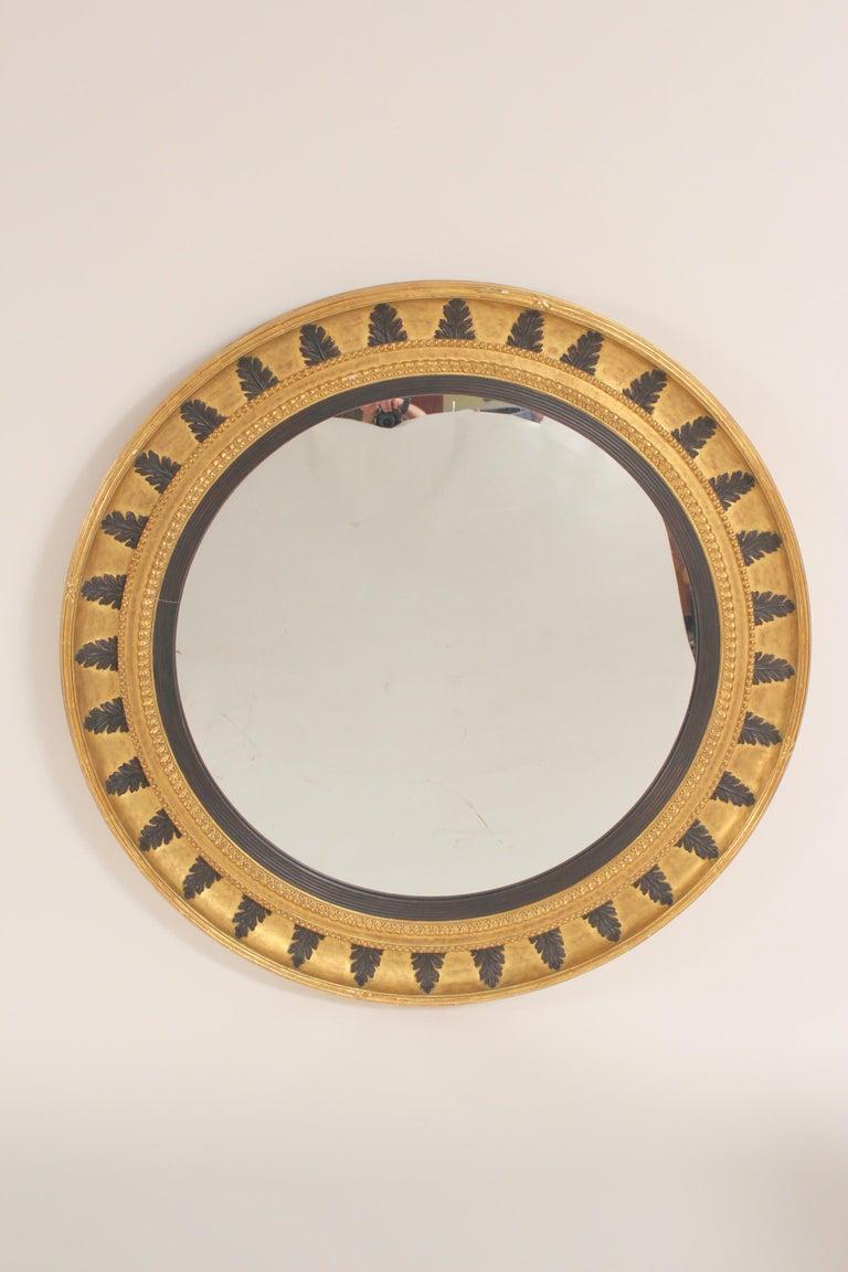 Pair of neo classical style gilt wood bulls eye mirrors, circa late 20th century.