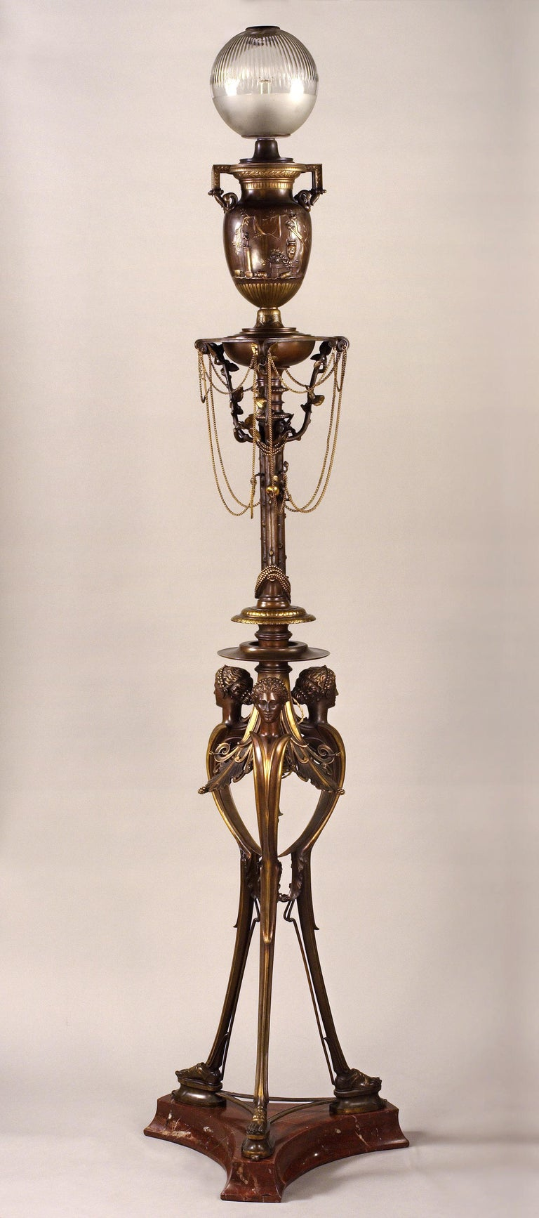 Model presented at the Paris Universal exhibition of 1855. (see picture attached) (Reproduced in Great Exhibitions 1851-1900, J. Meyer, Antique Collector's Club, 2006, p°95)  Pair of neo-Greek floor lamps made in two patina bronze, with socles in