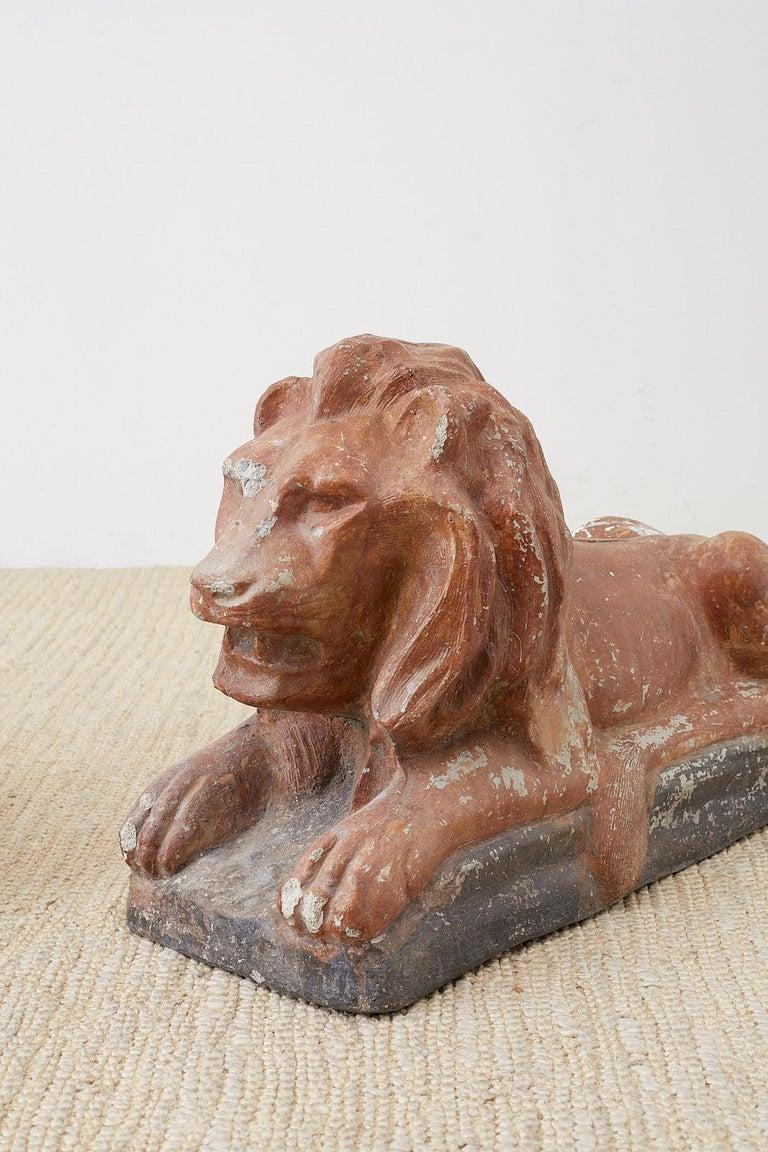 Italian Pair of Neoclassical Cast Stone Recumbent Lion Sculptures For Sale