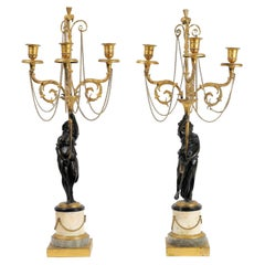 Pair of Neoclassical Directoire Gilt and Patinated Bronze Figural Candelabras